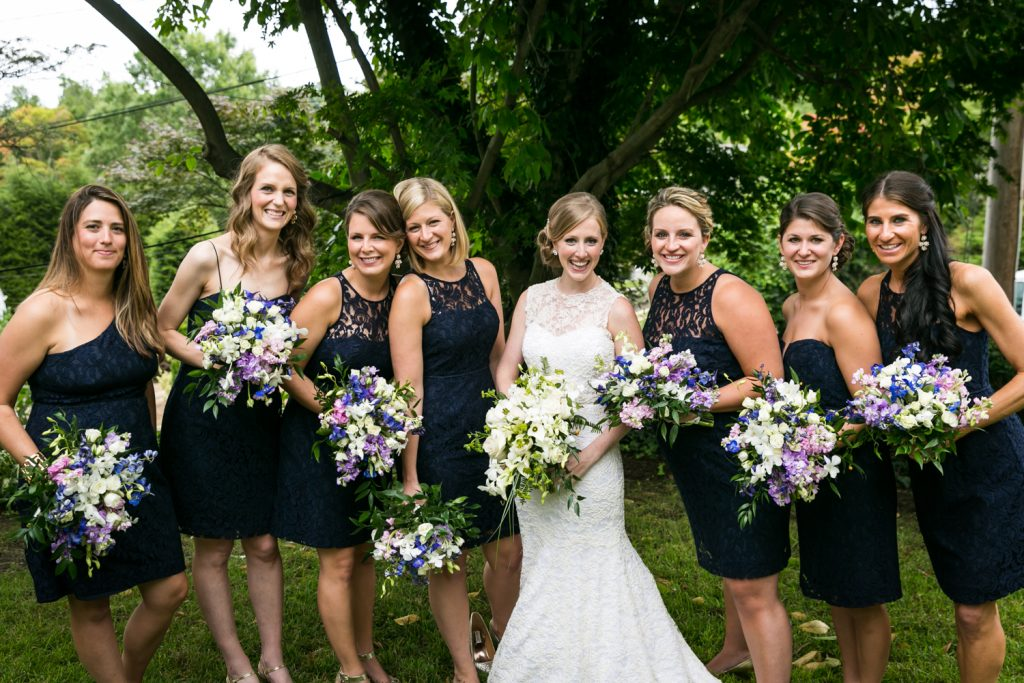 Portrait of smiling bride and bridesmaids at an American Yacht Club wedding