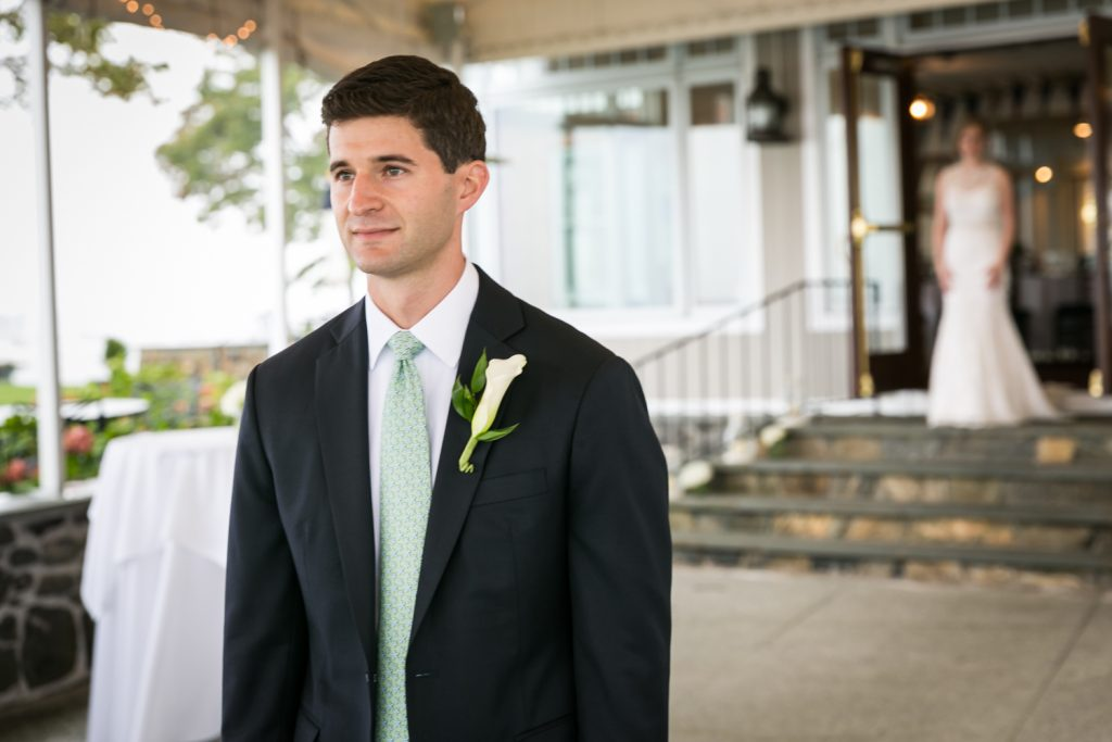 Groom waiting for bride during first look at an American Yacht Club wedding