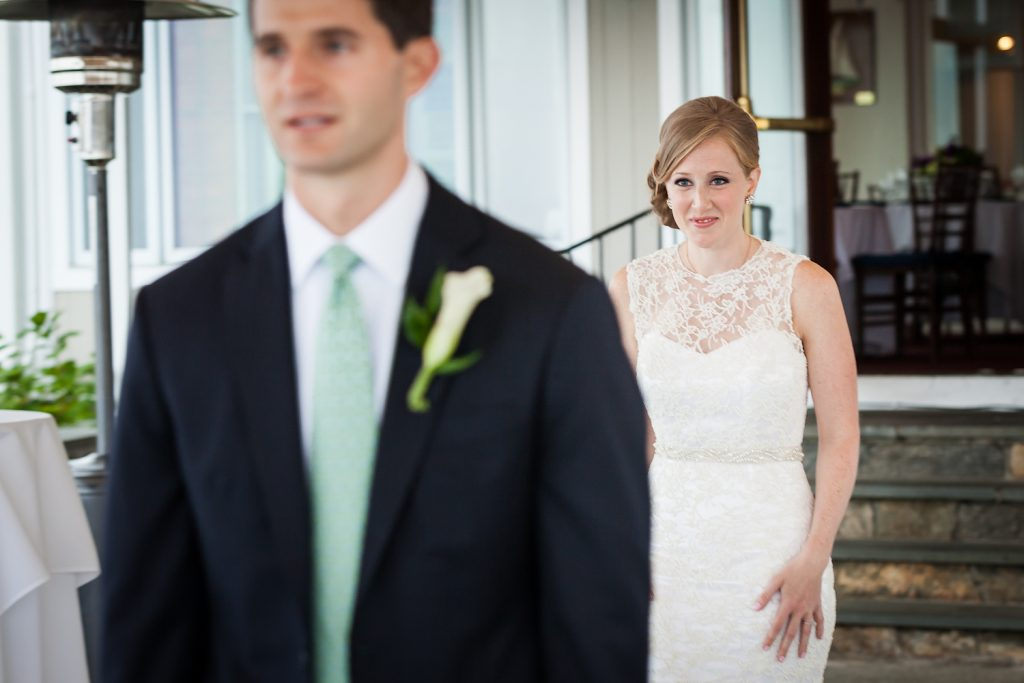 Bride about to approach groom during first look at an American Yacht Club wedding