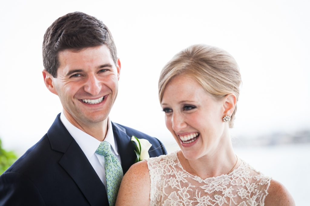 Smiling bride and groom at an American Yacht Club wedding