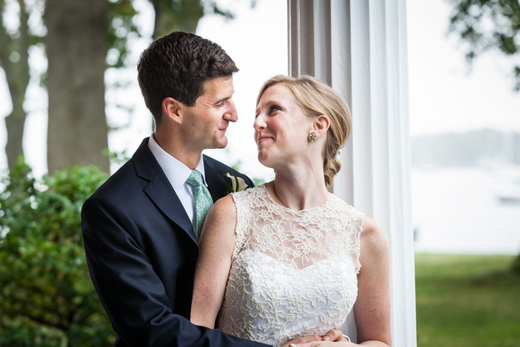 Bride and groom looking at each other at an American Yacht Club wedding