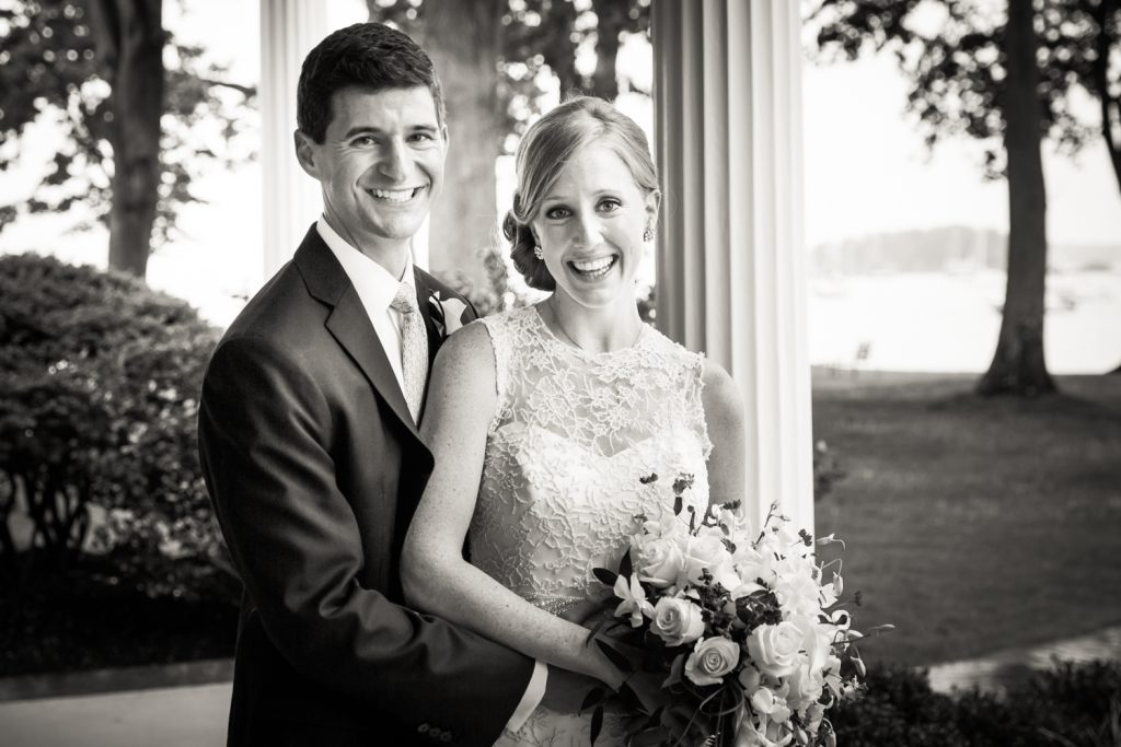 Black and white portrait of bride and groom at an American Yacht Club wedding
