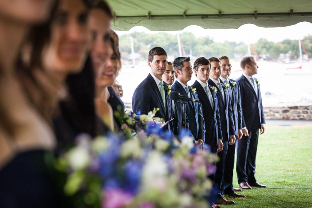 Bridal party in a line with groom looking for bride at an American Yacht Club wedding