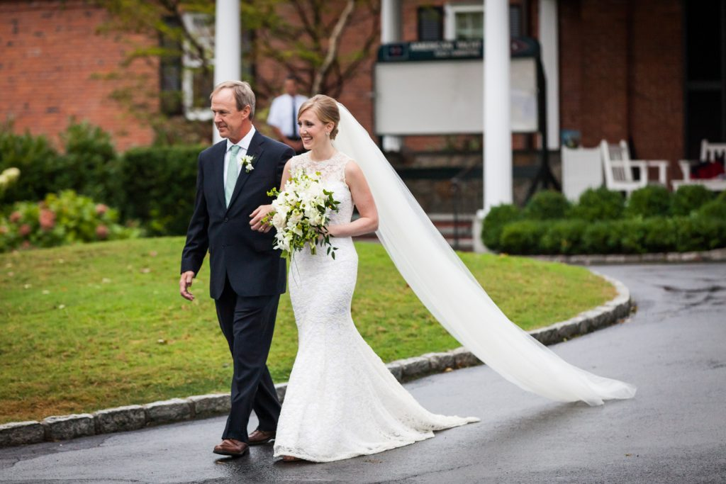 Bride and father walking to ceremony at an American Yacht Club wedding