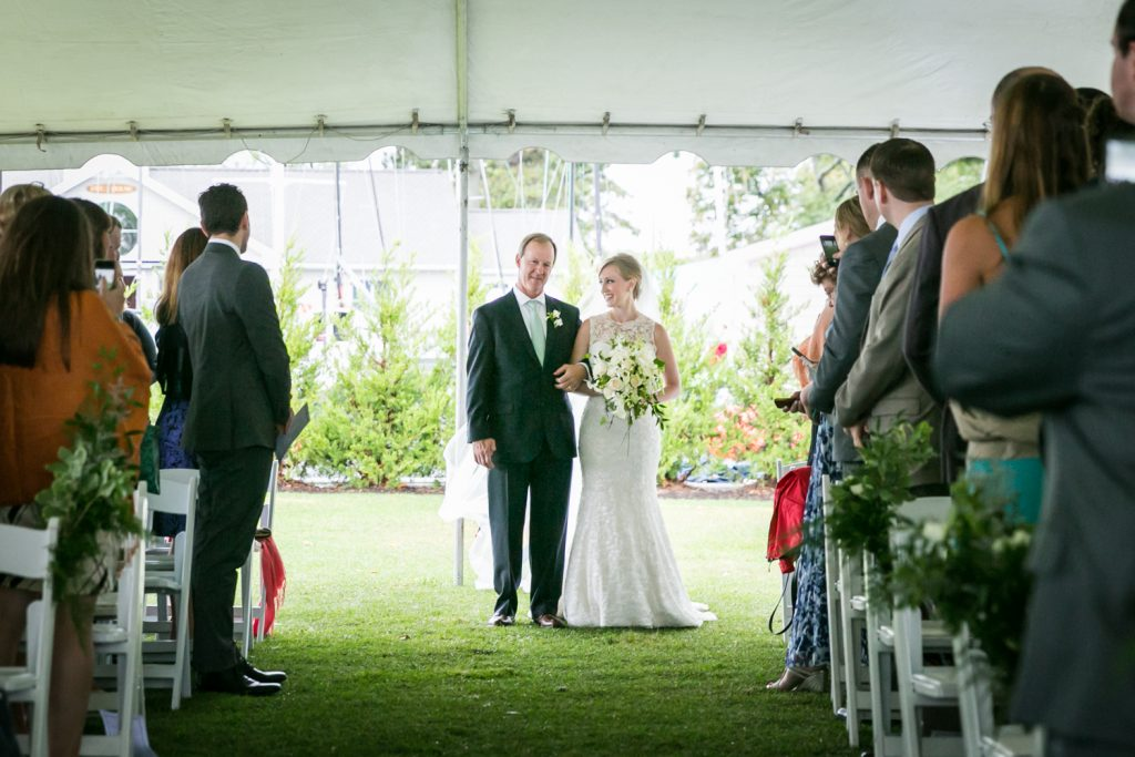 Bride and father at end of aisle during ceremony at an American Yacht Club wedding