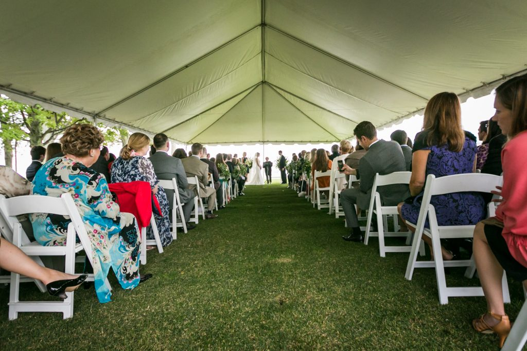 Wide shot of aisle in ceremony tent at an American Yacht Club wedding