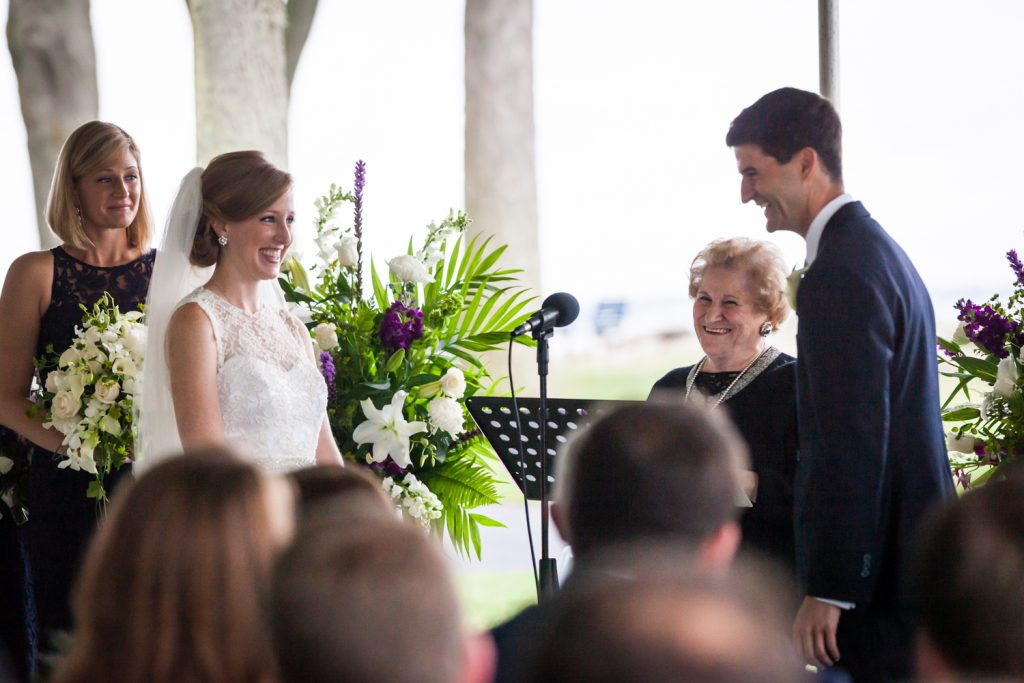 Bride and groom exchanging vows at an American Yacht Club wedding
