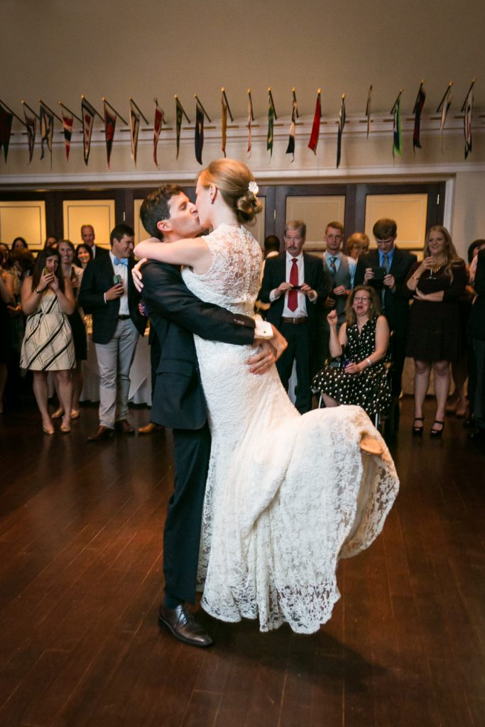 Groom lifting bride during first dance at an American Yacht Club wedding