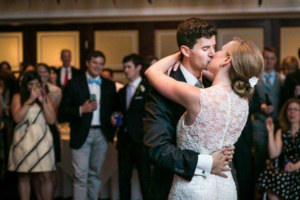 Bride and groom kissing during first dance at an American Yacht Club wedding