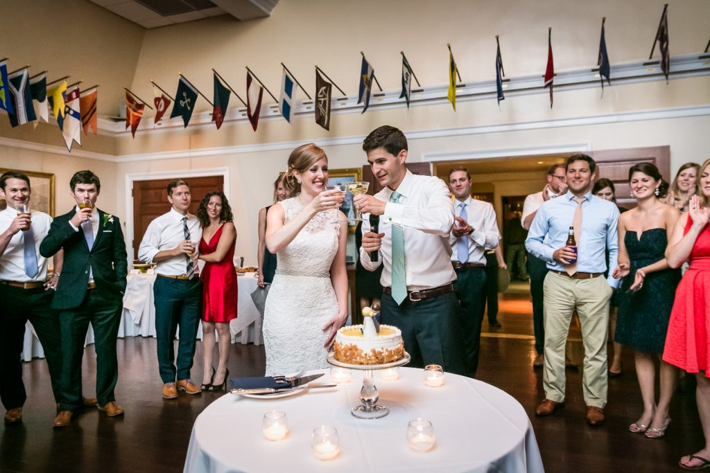 Bride and groom toasting champagne glasses at an American Yacht Club wedding