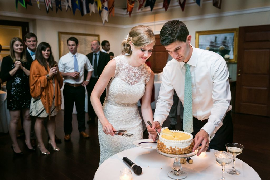 Bride and groom cutting cake at an American Yacht Club wedding