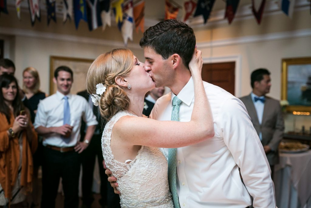 Bride and groom kissing at an American Yacht Club wedding