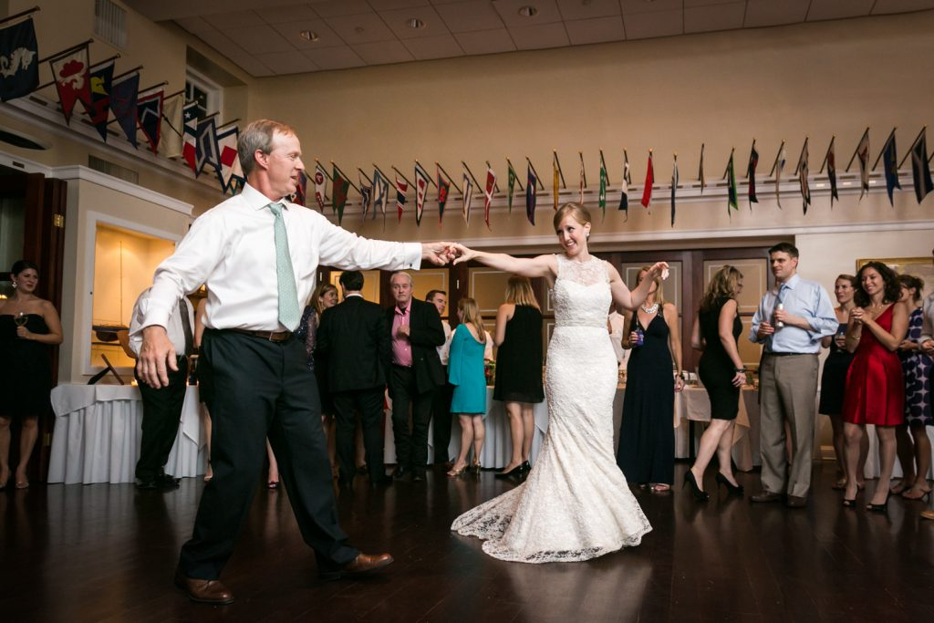 Bride dancing with father with arms outstretched