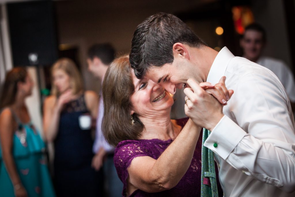 Groom dancing with mother at an American Yacht Club wedding