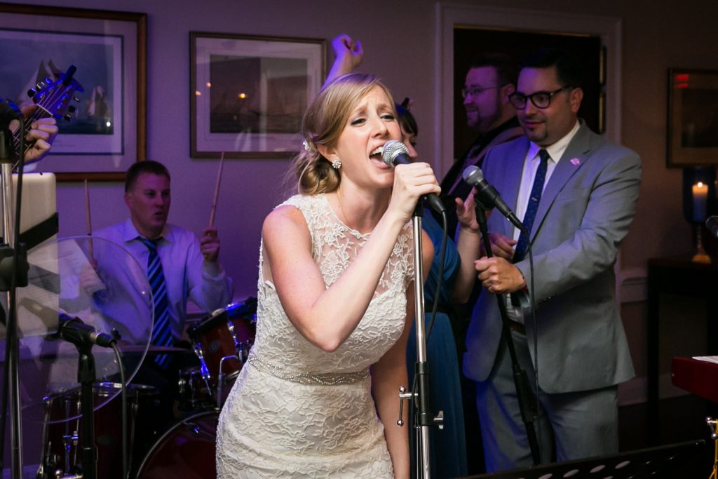 Bride singing into a microphone
