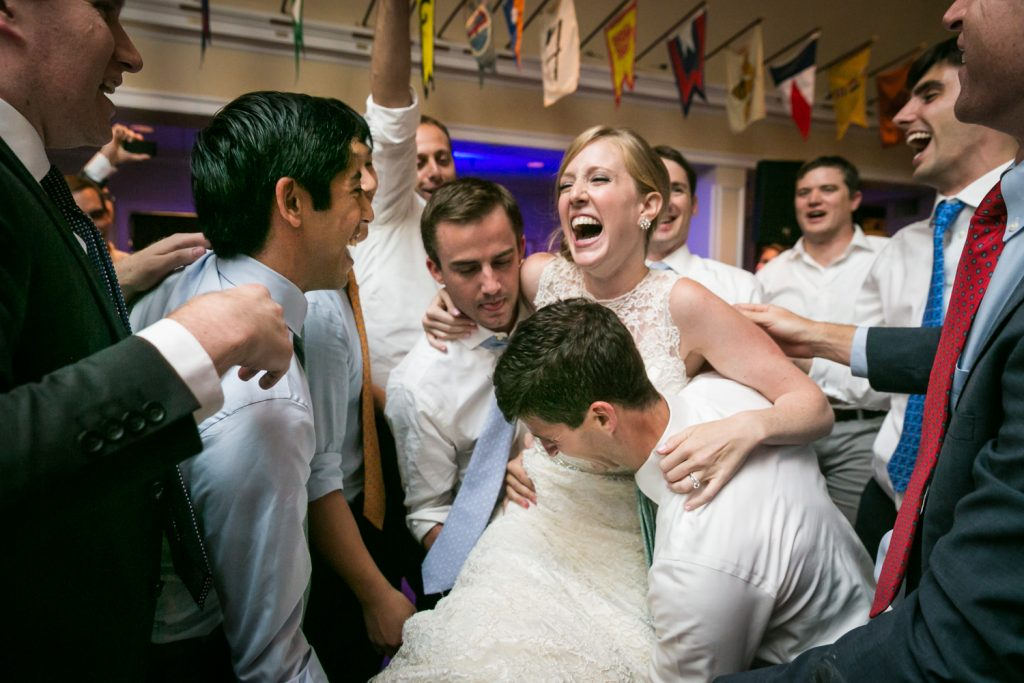 Bride lifted in the air by guests