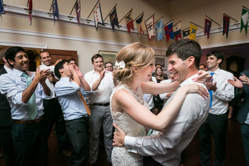 Bride and groom dancing in front of guests at an American Yacht Club wedding