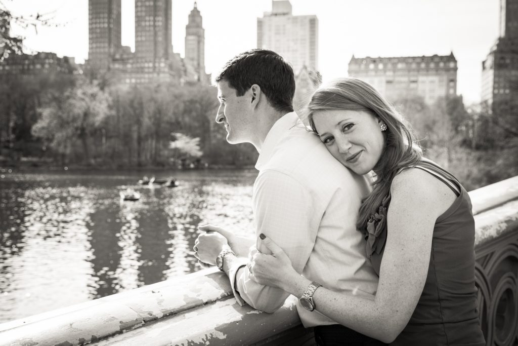 Black and white photo of woman hugging man on Bow Bridge