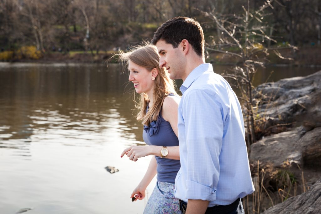 Couple skipping stones in Central Park lake