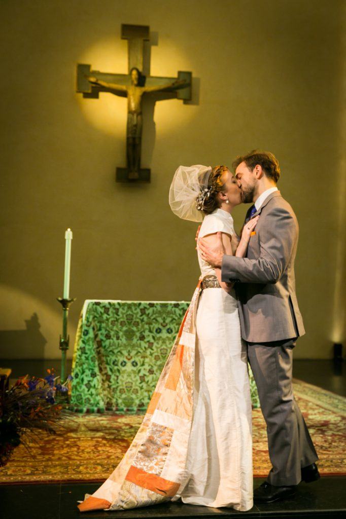 Bride and groom kissing at altar during Oratory of St. Boniface ceremony