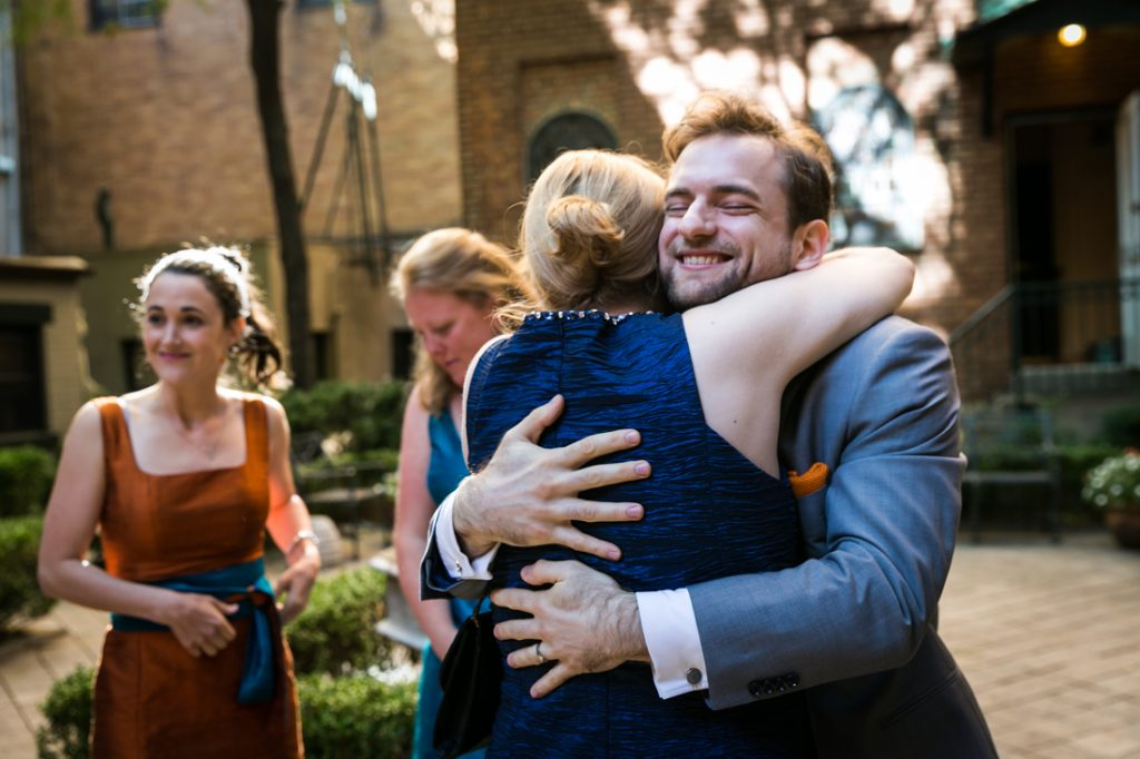 Groom hugging woman after Oratory of St. Boniface ceremony
