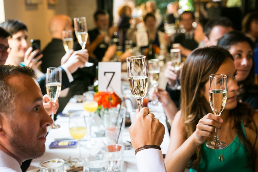 Guests raising champagne flutes during Farm on Adderley wedding reception