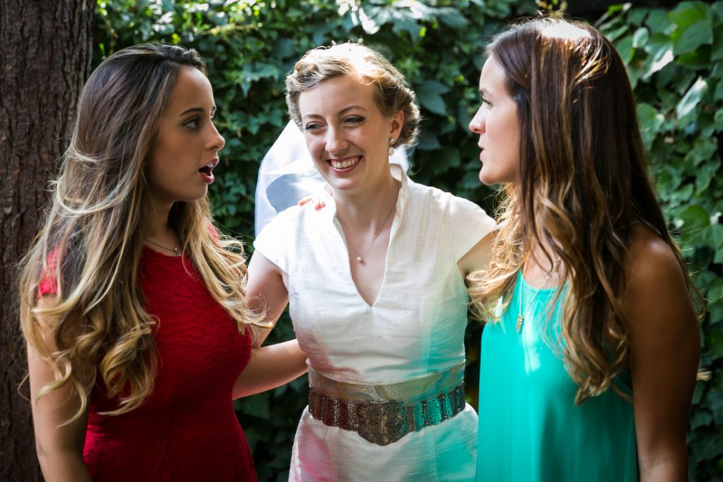 Bride laughing with two female guests during Farm on Adderley wedding reception