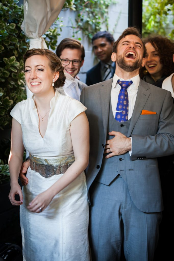 Bride and groom laughing during Farm on Adderley wedding reception