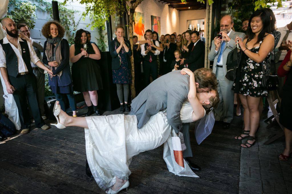 Groom and bride kissing on dance floor during Farm on Adderley wedding reception