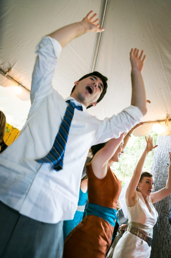 Guests dancing with arms raised during Farm on Adderley wedding reception