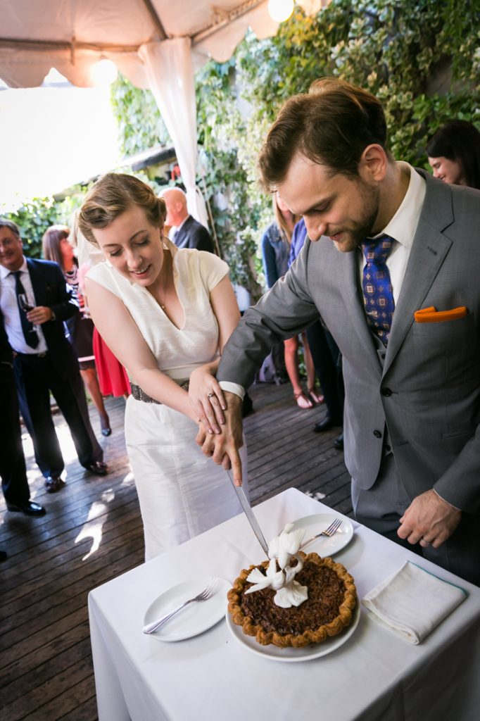 Bride and groom cutting pie during Farm on Adderley wedding reception