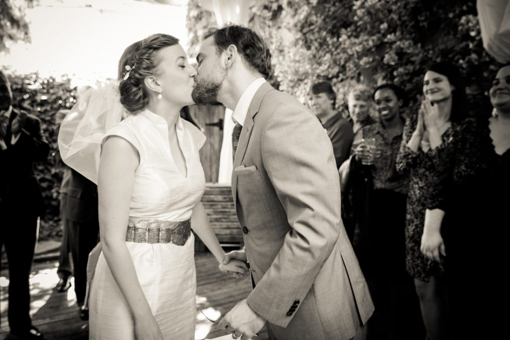Black and white photo of bride and groom kissing during Farm on Adderley wedding reception