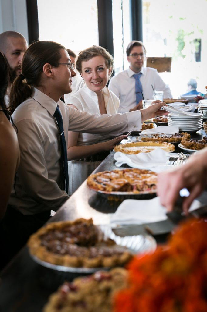 Bride and guests in front of pies during Farm on Adderley wedding reception