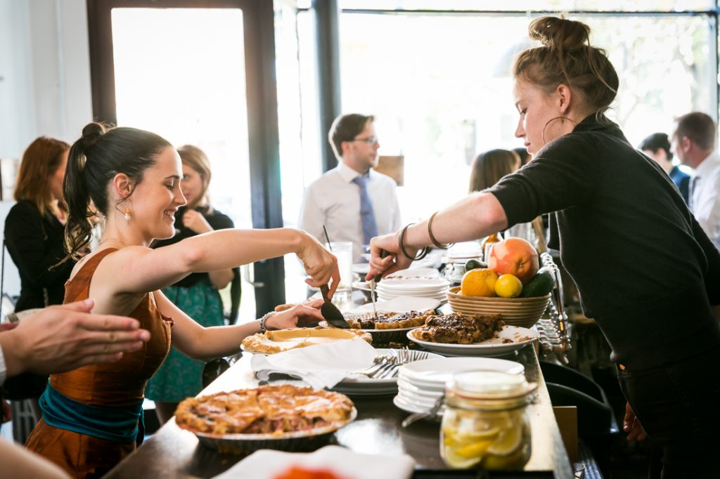 Waitress serving guest a slice of pie during Farm on Adderley wedding reception