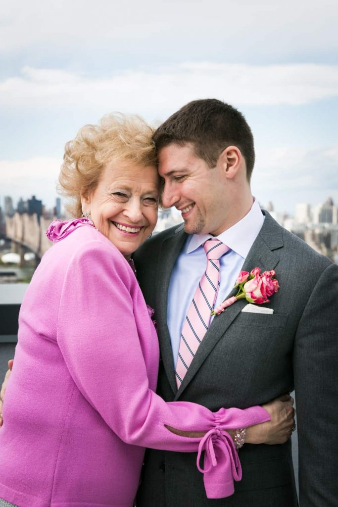 Groom and grandmother hugging on roof
