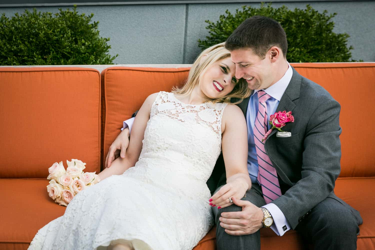 Bride and groom cuddling on couch