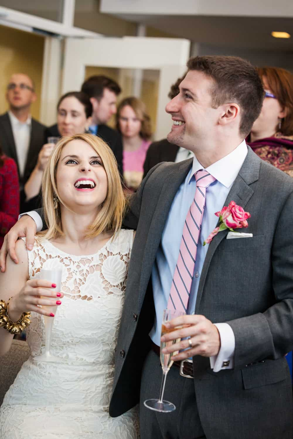 Bride and groom laughing during cocktail hour