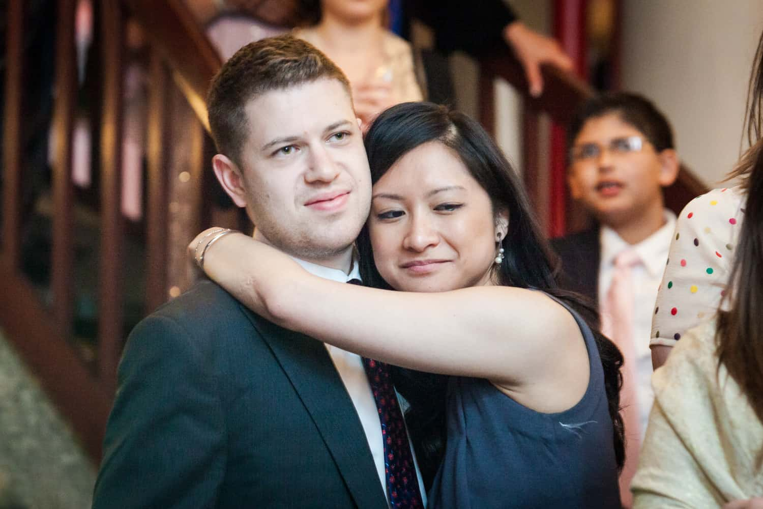 Couple hugging at a Housing Works wedding