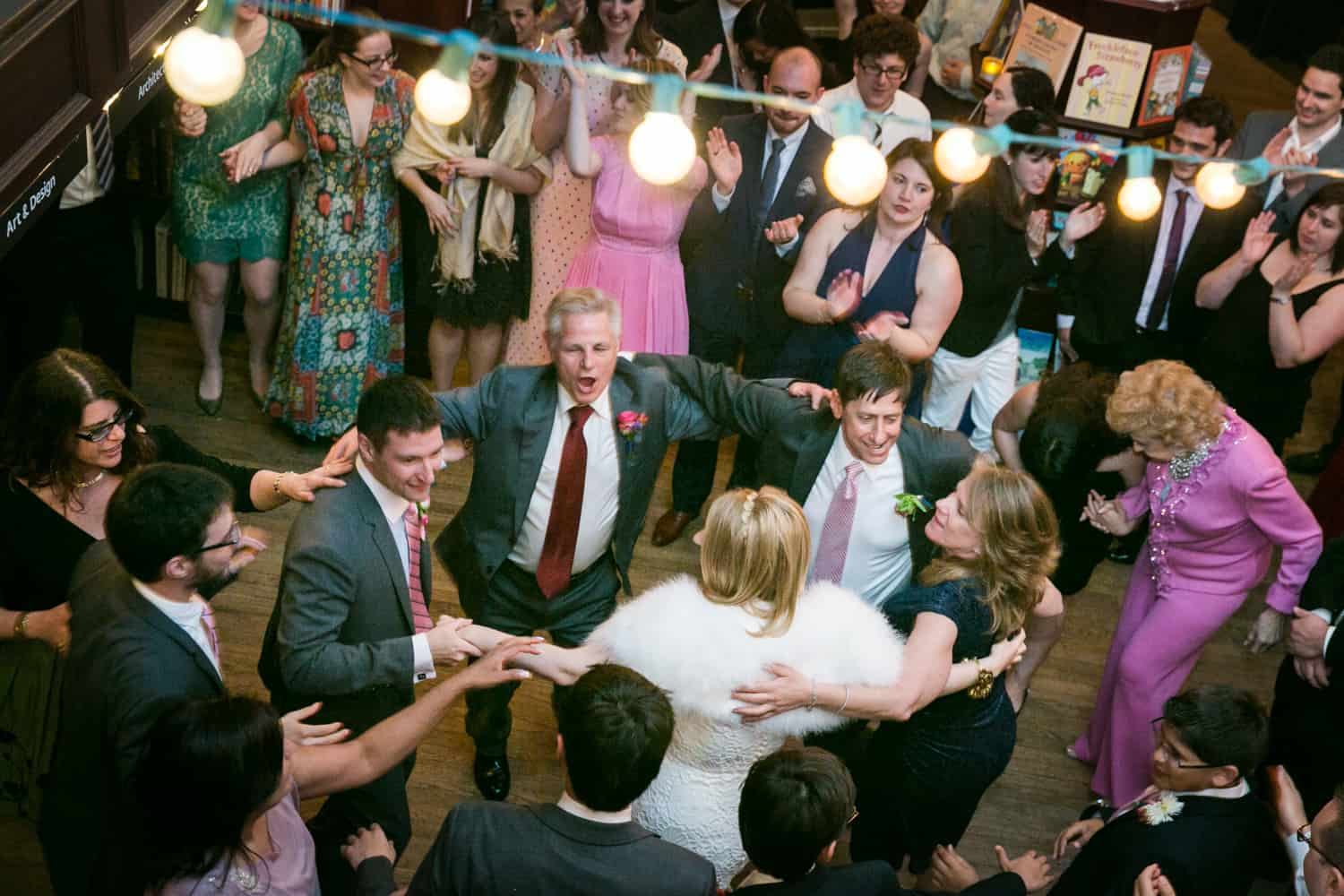 Bridal party dancing in circle hora dance at a Housing Works wedding