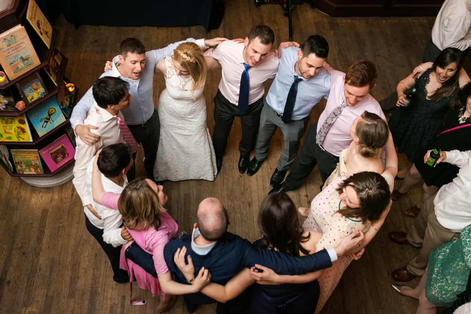Guests hugging in circle at a Housing Works wedding