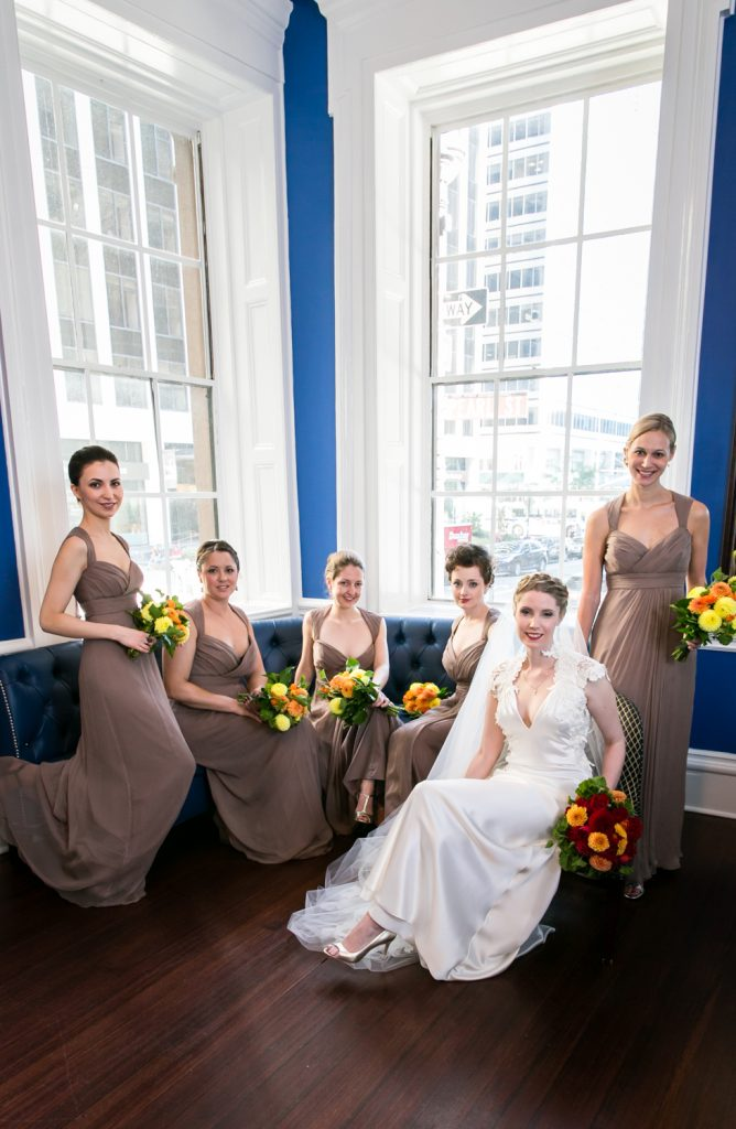 Portrait of bridesmaids in front of window at an India House wedding