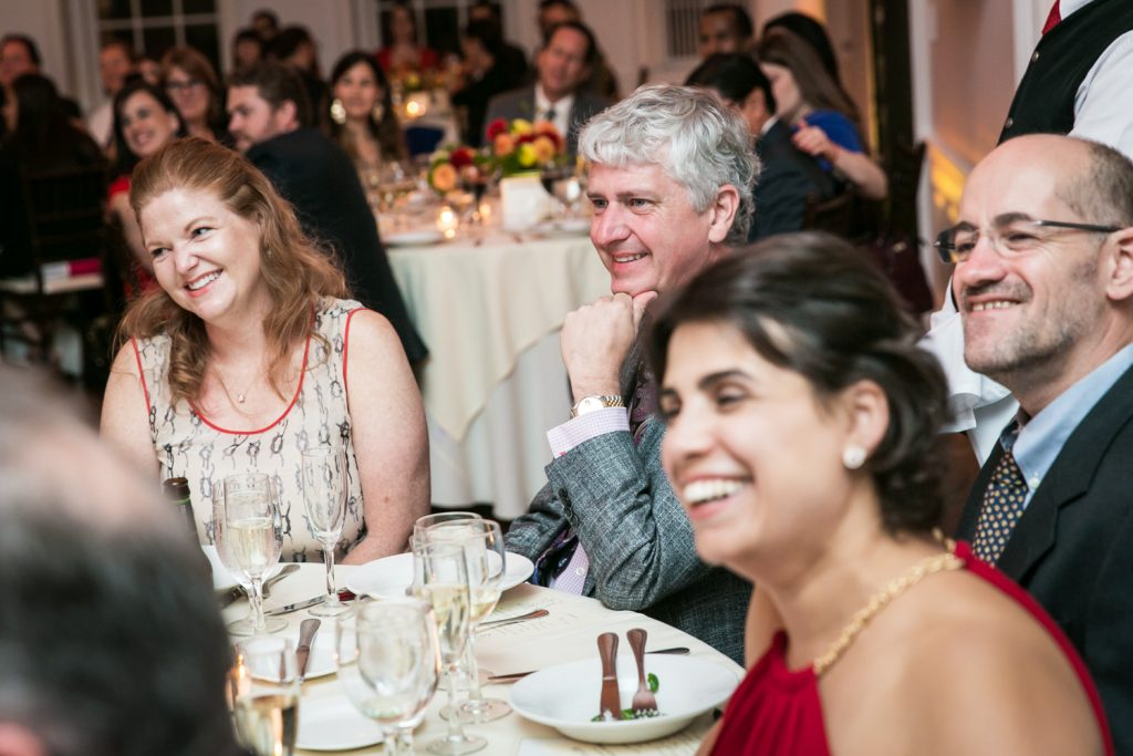 Guests laughing at tables at an India House wedding