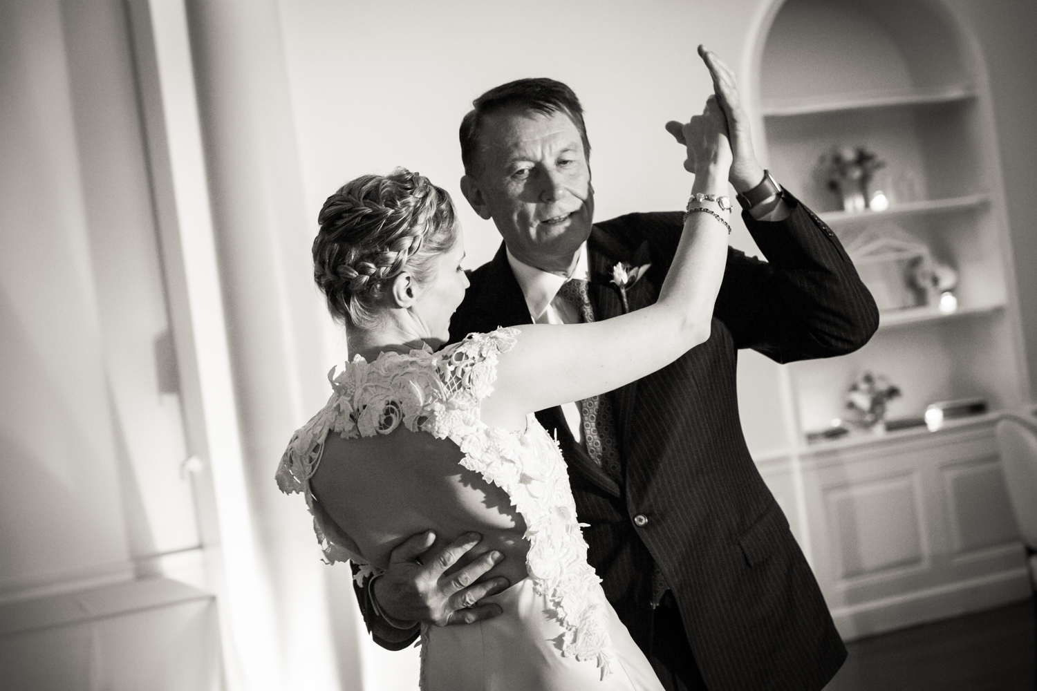 Black and white photo of father and bride dancing
