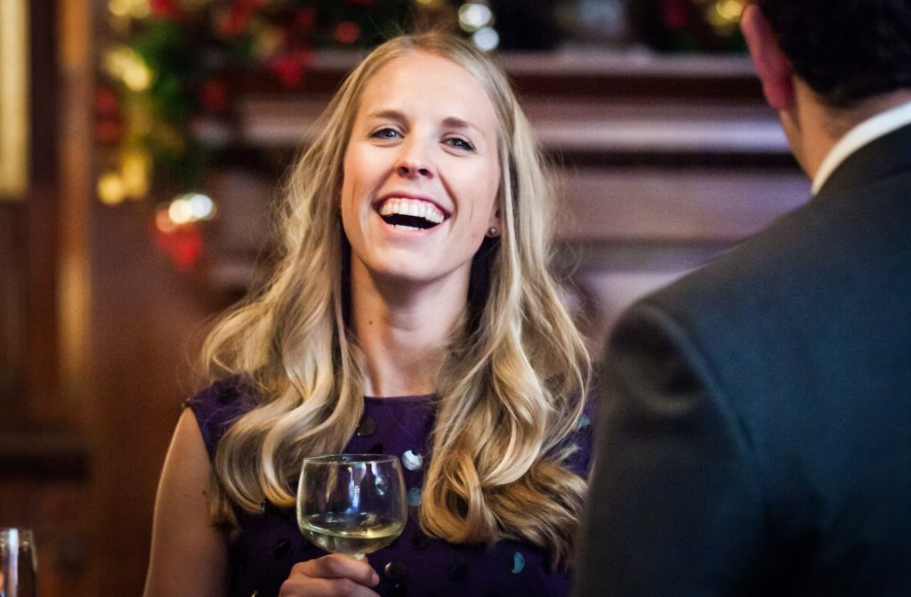 Woman with blonde hair laughing at a Lotos Club engagement party