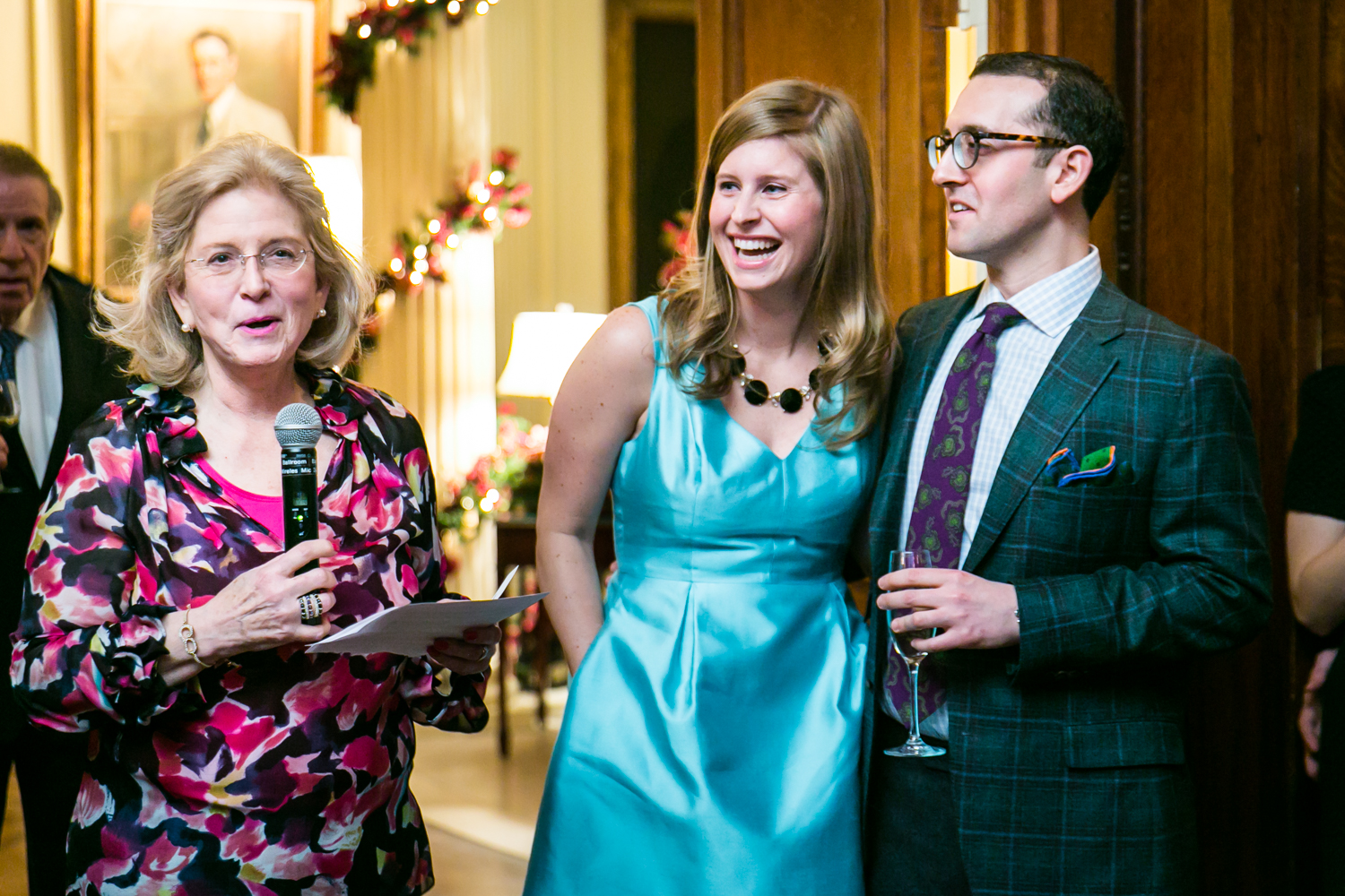 Mother of the groom making a speech in front of couple at a Lotos Club engagement party