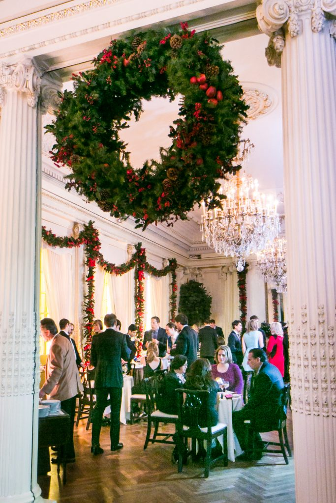 Christmas wreath between two columns in lobby of Lotos Club