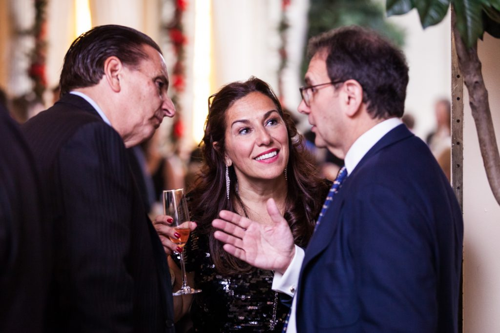 Three guests talking at a Lotos Club engagement party