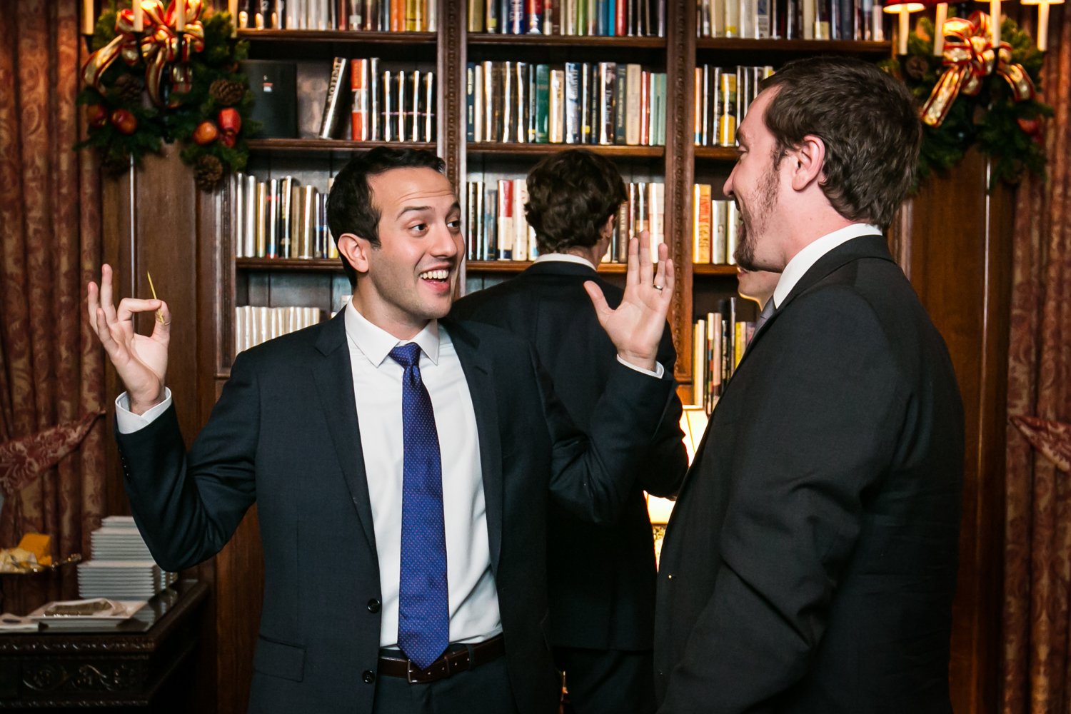 Two male guests talking at a Lotos Club engagement party