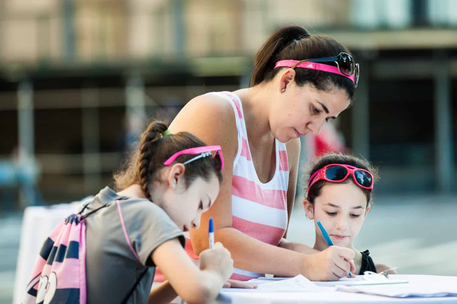 NYC Race for the Cure photos of woman and her two daughters filling out paperwork