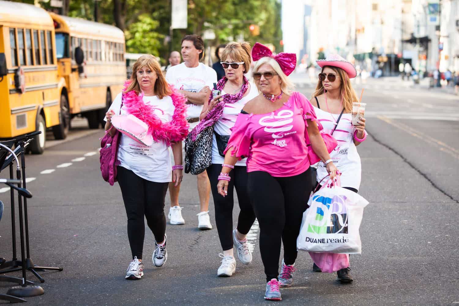 NYC Race for the Cure photos of group of supporters wearing pink outfits